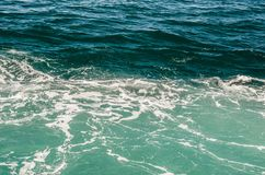 Green and azure surface of the sea. With white foam Stock Photos