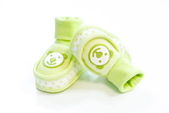 Green baby booties with dots. On a white background Stock Photo