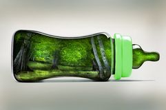 Green Baby bottle. Baby bottle with green trees within Stock Images