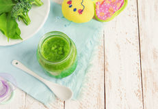 Green baby food Stock Images