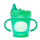 Green baby plastic cup. Green baby plastic cup with handles isolated over white background royalty free stock photography