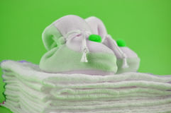 Green Baby Shoes on Cotton Diapers Stock Photo