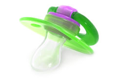Green baby silicone pacifier Royalty Free Stock Image