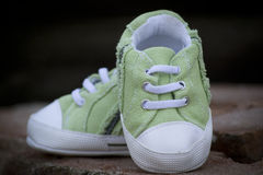 Green baby sneaker shoe Royalty Free Stock Images