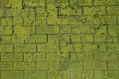 Green background. Weathered, grungy green brick wall background royalty free stock image