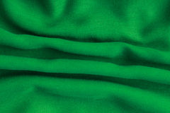 Green background abstract cloth wavy folds of textile texture Royalty Free Stock Images