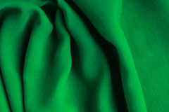 Green background abstract cloth wavy folds of textile texture Royalty Free Stock Image