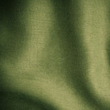 Green background abstract cloth wavy folds of textile texture. Wallpaper design of elegant material. Square format Royalty Free Stock Photos