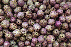 Green background of artichokes for sale in Italian market Royalty Free Stock Images