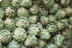 Green background of artichokes for sale Royalty Free Stock Photo