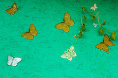 Green background with beautiful butterflies for your design Royalty Free Stock Photo