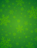 Green background with blurred snowflakes, vector stock photo