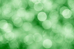 Green background with bokeh defocused lights Stock Photo
