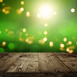 Green background with bokeh and an empty table Stock Photo