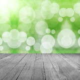Green background with bokeh and wood floor Royalty Free Stock Images
