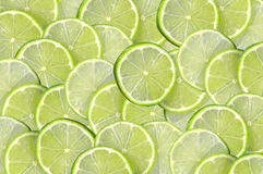 Green background with citrus-fruit of lime slices Royalty Free Stock Photo