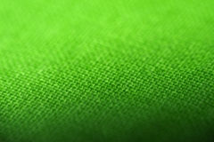Green background. Closeup of green cloth, thread details Royalty Free Stock Photography