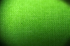 Green background. Closeup of green cloth, thread details Royalty Free Stock Photos