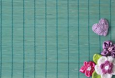Green background with crochet flower and heart. Green background with crochet flower and lilac heart Stock Image