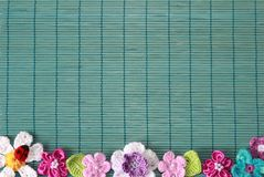 Green background with crochet flower and heart. Green background with crochet flower and lilac heart Stock Photos