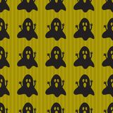 Halloween background with spooky ghosts. Green background design with black ghost pattern. Halloween theme clean design Stock Images