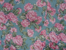 Green background fabric roses and leaves Royalty Free Stock Photography