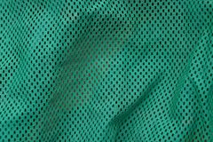 Texture of tissue from a fragment of matter with small holes. Green background of a fragment of matter with small holes Stock Images