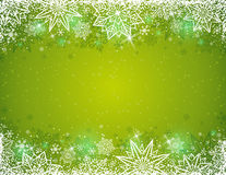 Green background with frame of snowflakes and stars, vector royalty free stock images