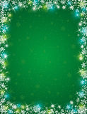 Green background with  frame of snowflakes Royalty Free Stock Image