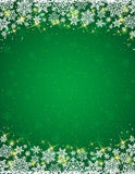Green background with  frame of snowflakes Royalty Free Stock Photos