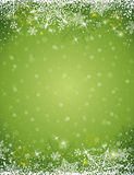 Green background with  frame of snowflakes,  vector Stock Photo