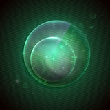 Green background with a glass transparent sphere. Royalty Free Stock Images
