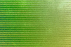 Green background. With horizontal scripes and some grudgy spots Royalty Free Stock Images