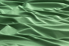Green background luxury cloth or wavy folds of grunge silk texture satin velvet. Abstract background luxury cloth or liquid wave or wavy folds of grunge silk Stock Image
