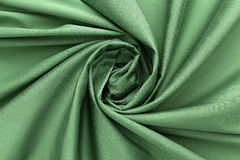 Green background luxury cloth or wavy folds of grunge silk texture satin velvet. Abstract background luxury cloth or liquid wave or wavy folds of grunge silk Royalty Free Stock Image