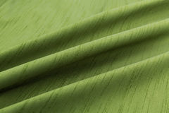 Green background luxury cloth or wavy folds of grunge silk texture satin velvet. Abstract background luxury cloth or liquid wave or wavy folds of grunge silk Stock Photos