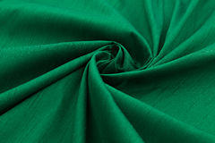 Green background luxury cloth or wavy folds of grunge silk texture satin velvet. Abstract background luxury cloth or liquid wave or wavy folds of grunge silk Stock Photography