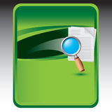 Green background with magnifying document Royalty Free Stock Photography