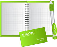 Green background from notebook with pen Stock Images