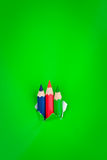 Green background with pencils Royalty Free Stock Photography