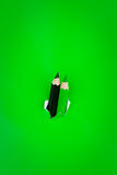 Green background with pencils Royalty Free Stock Photos