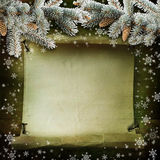 Green background with pine branches, snowflakes and paper with space for text Royalty Free Stock Image
