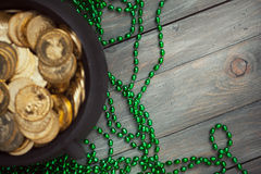 Green: Background with Pot Of Gold and Green Bead Necklaces Royalty Free Stock Photo