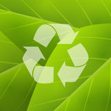 Green background with recycling symbol Royalty Free Stock Photo