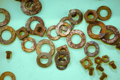 Green background with rusty washers. Lots of rusty washers on green background Stock Images