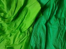 Green background silk surface empty blank sheets vivid colors. Green paper background silk surface empty blank sheets vivid colors orange Royalty Free Stock Images