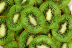 Green background slices kiwi Royalty Free Stock Photos
