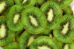 Green background slices kiwi Royalty Free Stock Photos