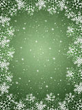 Green  background with snowflakes Royalty Free Stock Image