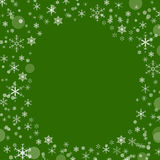 Green background with snowflakes Royalty Free Stock Photos